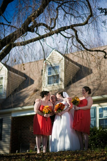 Bridesmaids under cherry tree.
