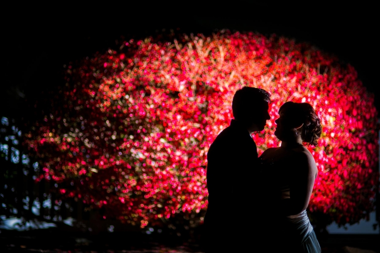 Artistic night photo of bride and groom at wedding